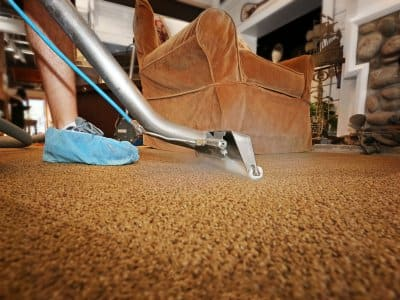 Man steam cleaning carpet