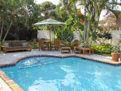 in-ground swimming pool with outdoor sitting area