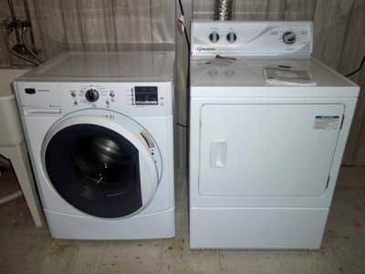 front load washer and clothes dryer in laundry room