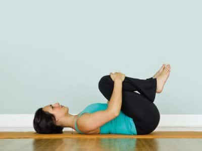 A woman practices yoga