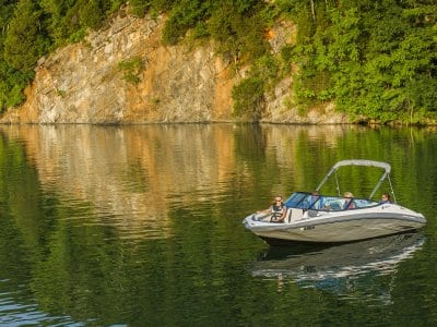 boat on a lake with rock outcropping