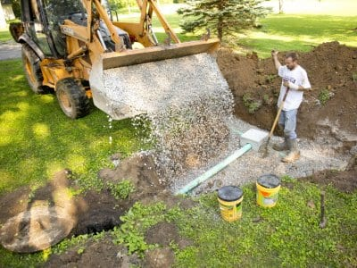 Gravel dumped on septic system construction site