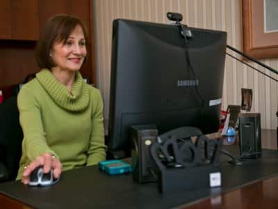 Pam Slibeck at her desktop computer