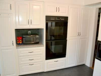 white kitchen cabinets and oven