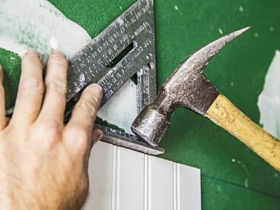 hands using hammer and triangle tool