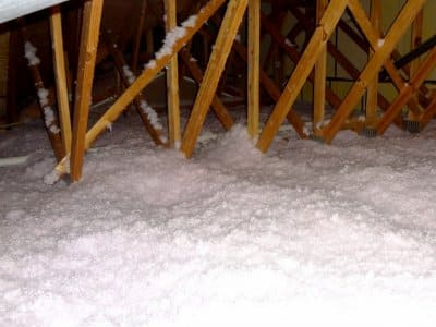white, fluffy cellulose insulation in attic