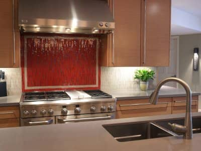 stove and countertop with under cabinet lighting