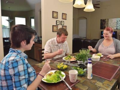 a family having a healthy salad dinner at home