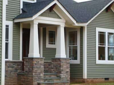 home exterior with brick porch