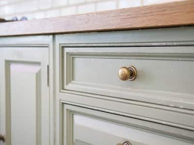 old green drawer and cabinets