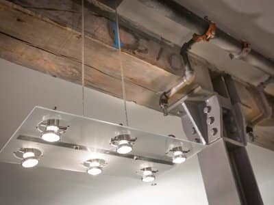 contrasting industrial building materials and modern light fixture