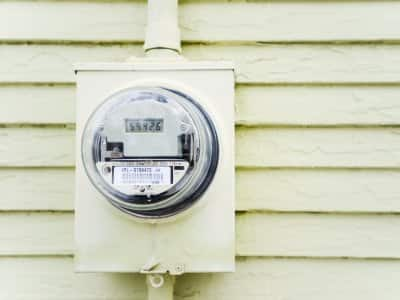 Electric meter and electric meter socket on outside of siding