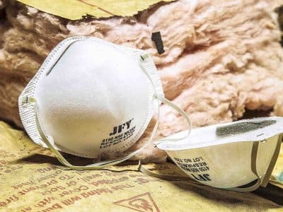 fiberglass insulation with dust masks