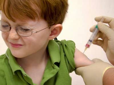 A child gets a shot