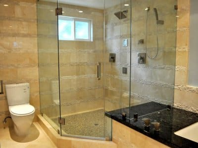 A small bathroom with frameless glass shower doors