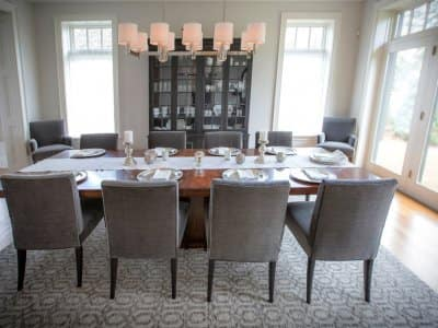 eight person dining table, gray tones, hardwood floors, chandelier