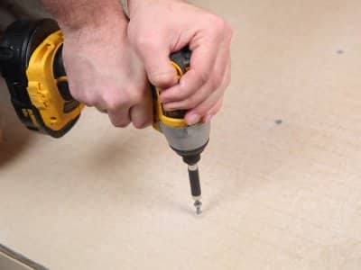 Handyman using drill