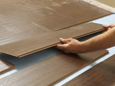 Lifting interlocking laminate flooring planks