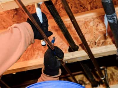 Plumber's hands attaching pipe