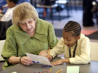 child working with tutor