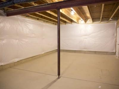 Load-bearing metal wall beam with supporting post in unfinished basement