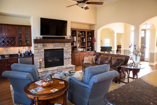 Great Room With Stone Fireplace Built In Bar Bookcase