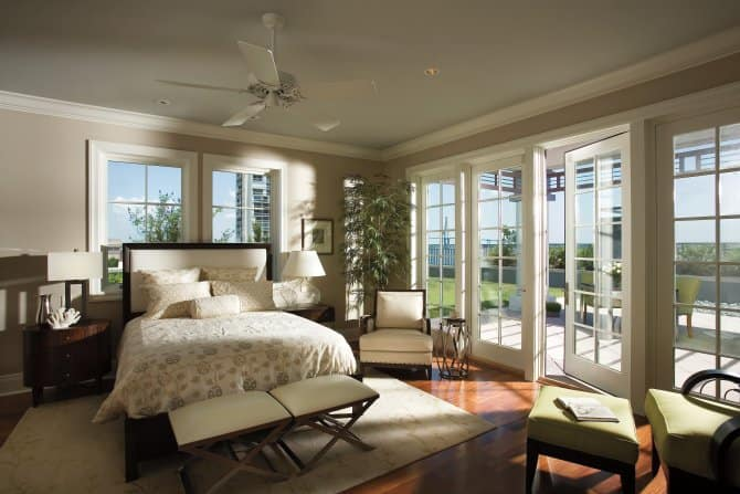 Master Bedroom With French Doors Leading to a Patio ...