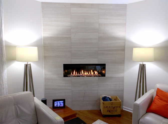 electric fireplace with decorative stones in gray living room rh angieslist com Electric Fireplace with Mosaic Tile Electric Fireplace with Mosaic Tile