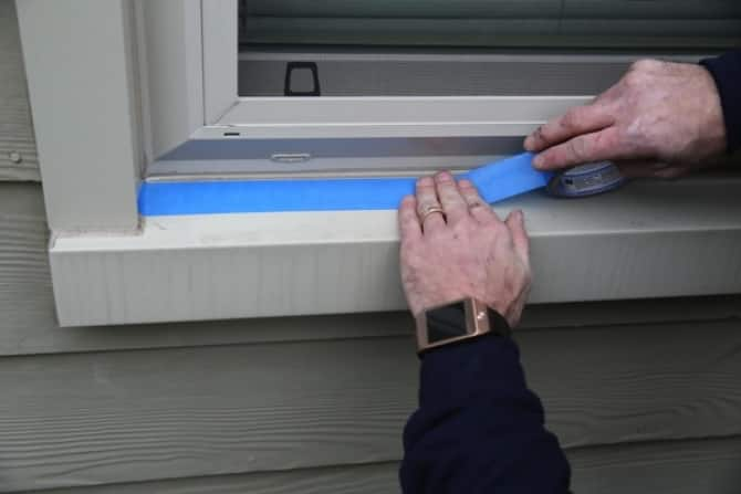 painters tape to caulk windows