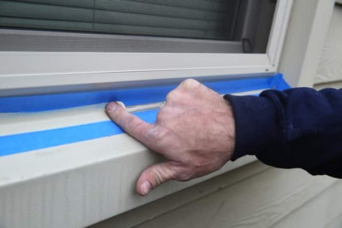 smoothing caulk around windows