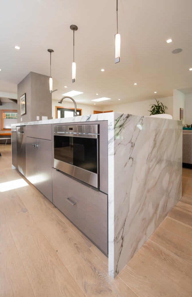 Kitchen Island With Appliances Cabinets And White Marble