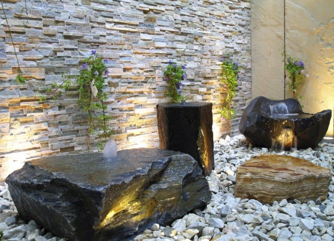 Rock Garden With Landscape Lighting And Bubbling Boulder Fountains.