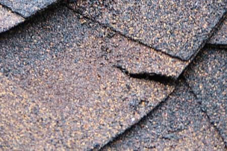 cracking and curling asphalt roofing shingles