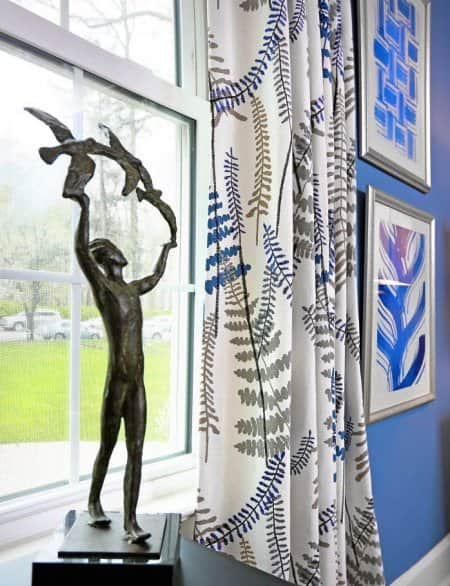 patterned curtains with statuette
