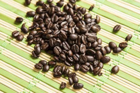 Coffee beans on a bamboo table mat