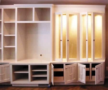 A Carpenter Built This Large Wall Unit With Three Sections For Bookshelves,  An Entertainment Center
