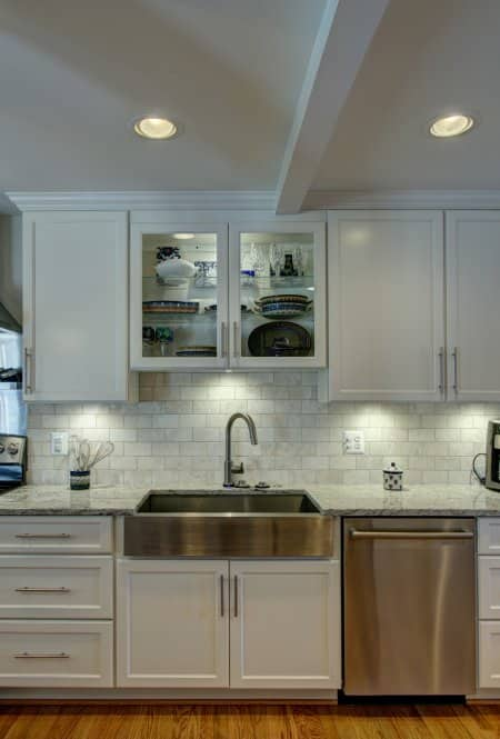 Kitchen Sink And Cabinets With Under Cabinet LED Lighting