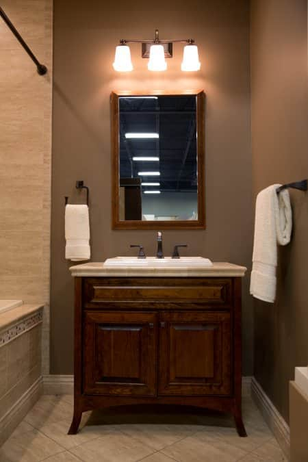 brown wood cabinet-style bathroom vanity
