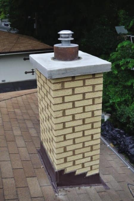 chimney with cap on top of roof