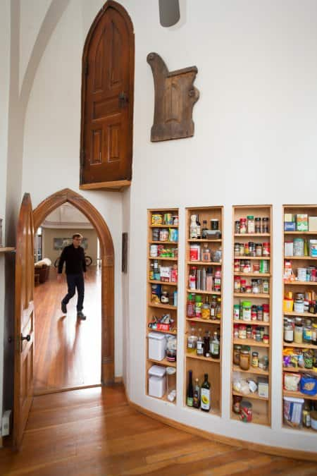 pantry under arched door to pulpit