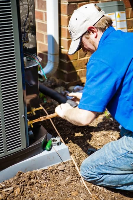 difference between best hvac brands angie s list hvac contractor installing an heating and air conditioning unit