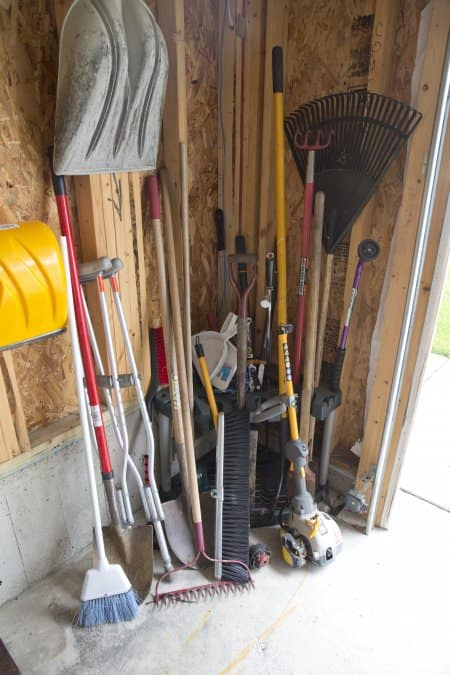 garage tools, rakes and shovels (Photo by Eldon Lindsay)