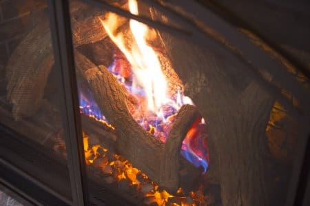 gas logs burning in fireplace