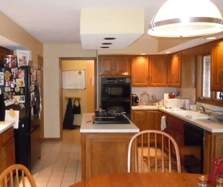 outdated kitchen with honey cabinets