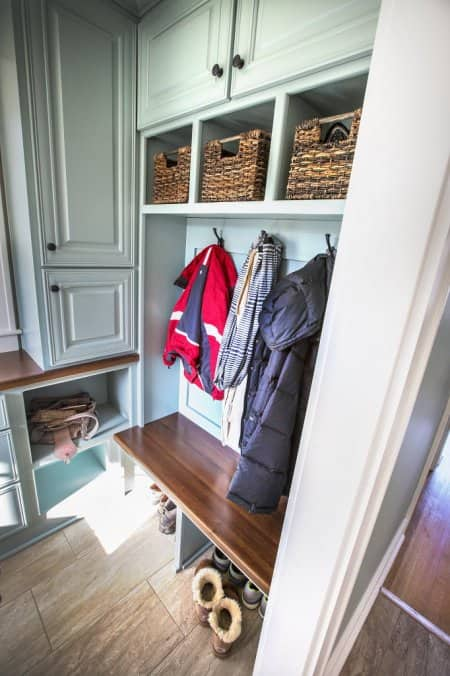 boots, coats and handbags stored in a mudroom