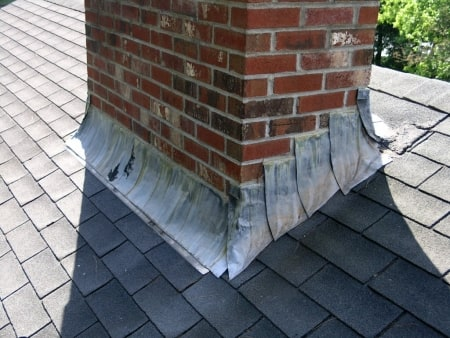 Flashing along the base of a chimney