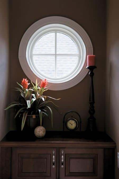 white circle window over dresser