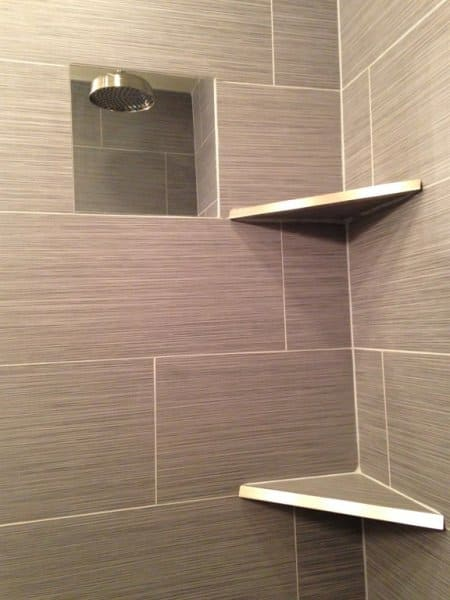 shower with wall niche and shelves