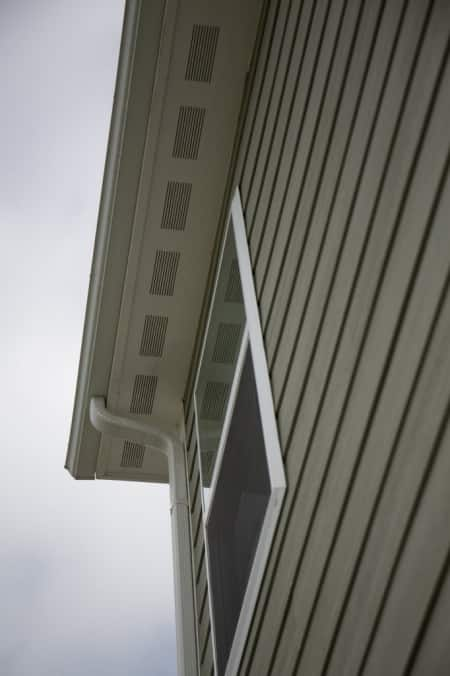 Siding, soffet and gutters on a home.