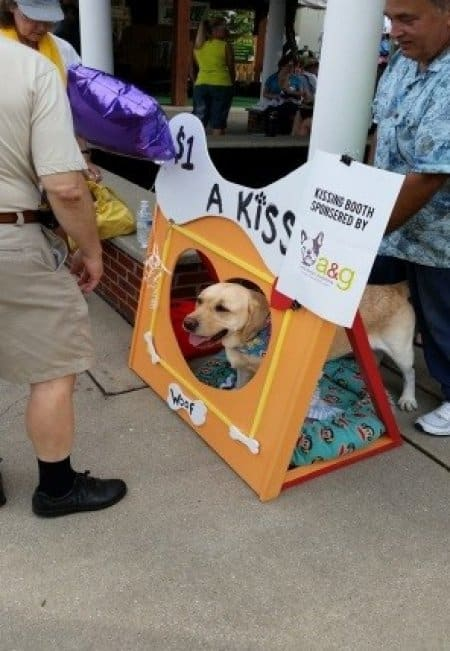 A kissing dog booth in Angie's List Gardens at the Indiana State Fair